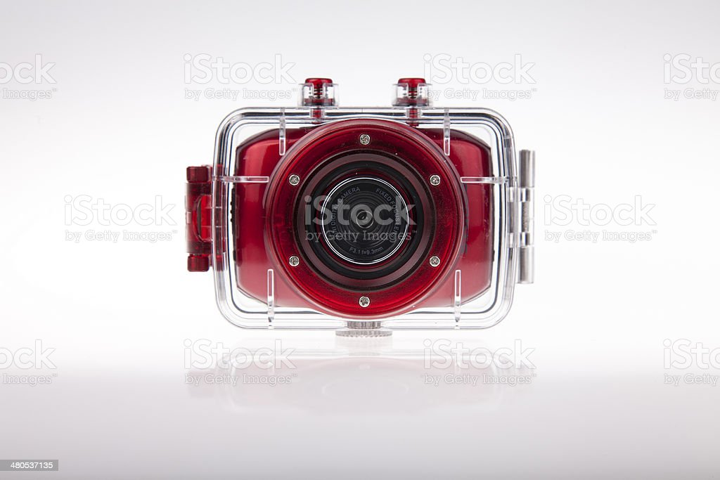 Underwater action video camera with waterproof case stock photo