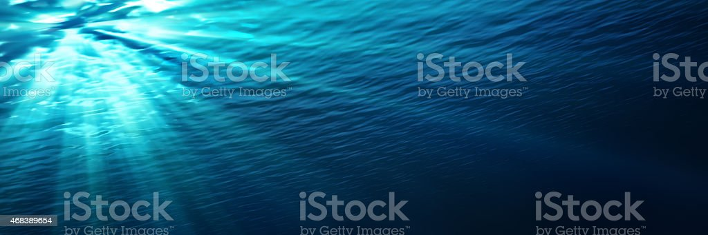 underwater - blue shining in deep of the sea stock photo