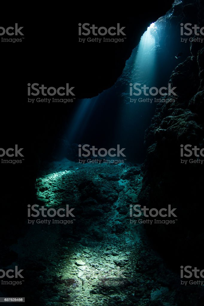 Underwater Cavern and Beams of Light stock photo