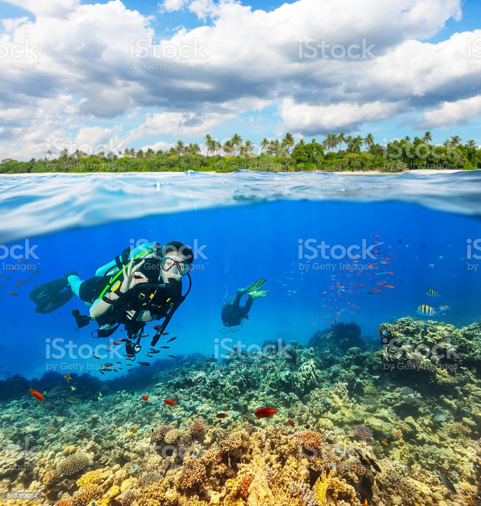 Underwater coral reef with scuba divers stock photo
