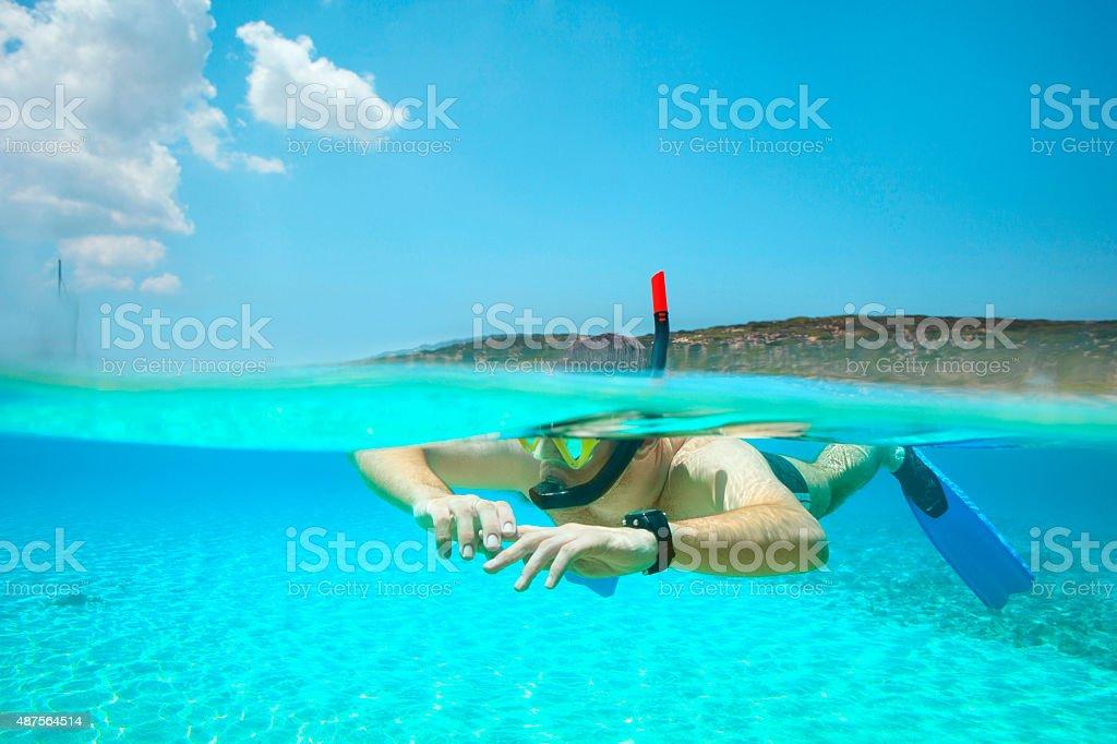 Underwater diving adventure  Young man snorkeling   Half-half  turquoise sea lagoon stock photo