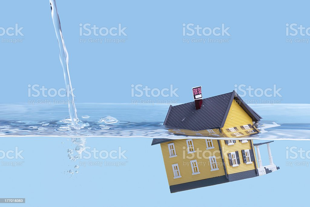 Underwater home mortgage, house for sale stock photo