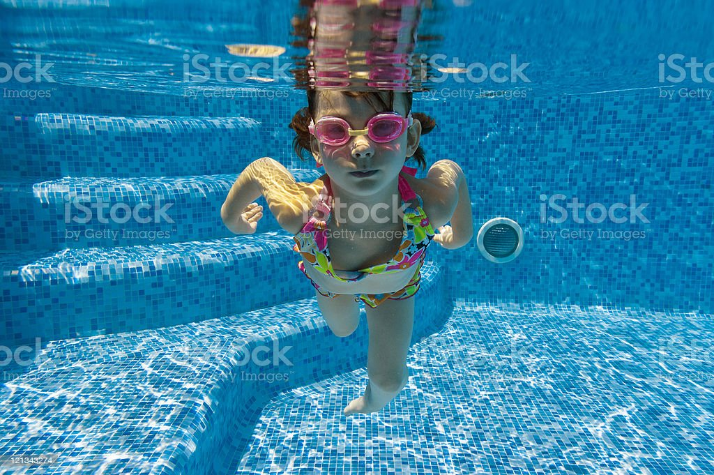 Underwater kid in swimming pool stock photo