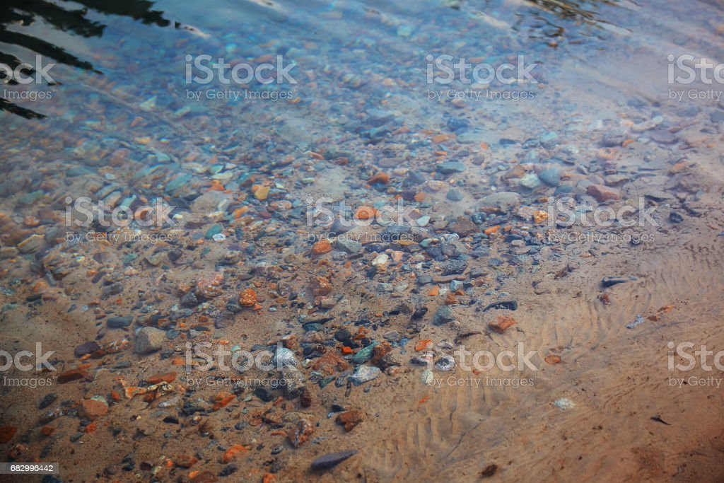 Underwater pebbles in the river stock photo