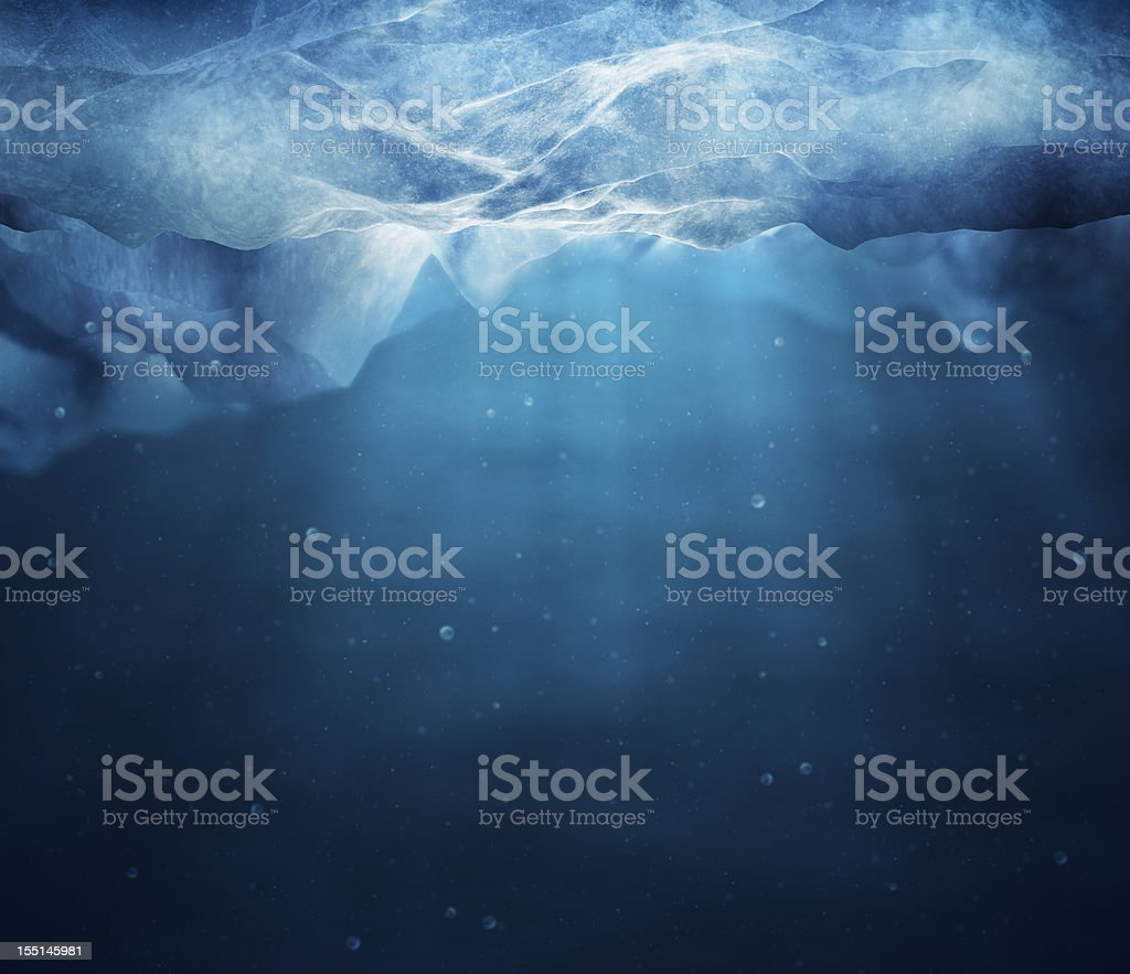 Underwater picture of sunbeams through layer of ice stock photo