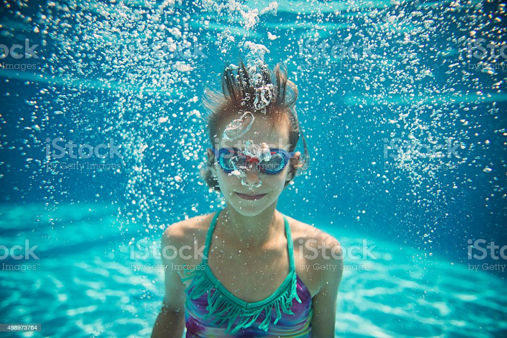 Underwater portrait of a little girl stock photo