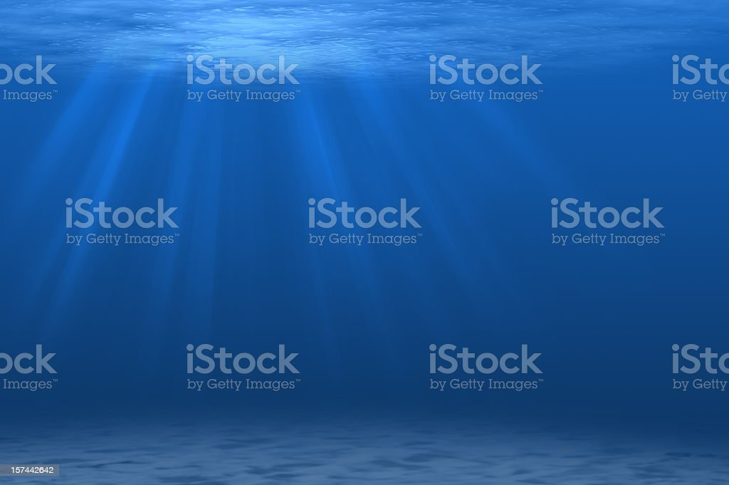Underwater scene with beams of sunlight streaming through stock photo