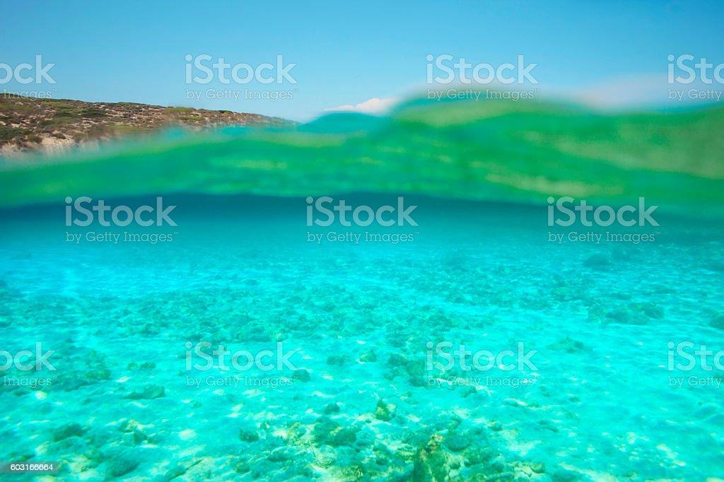 Underwater sea background    Overwater underwater split shot  beautiful lagoon stock photo