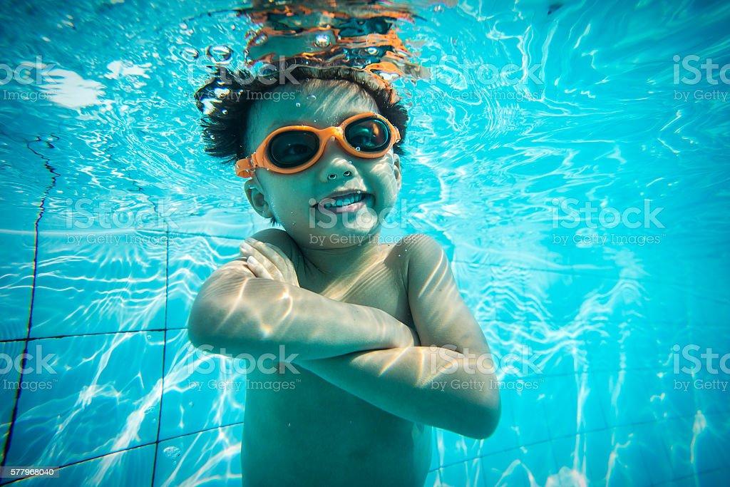 Underwater shot of boy swimming stock photo