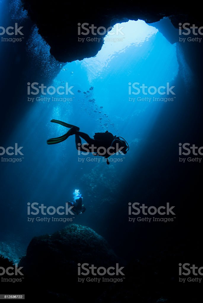 Underwater swimming stock photo