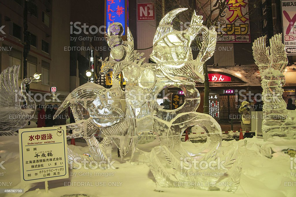 Underwater swimming theme sculpture at the 33rd Susukino Ice Festival royalty-free stock photo