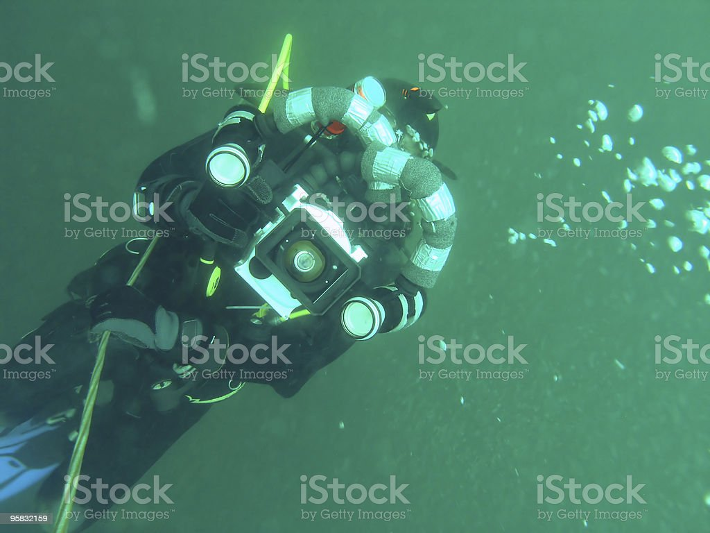 Underwater videographer royalty-free stock photo