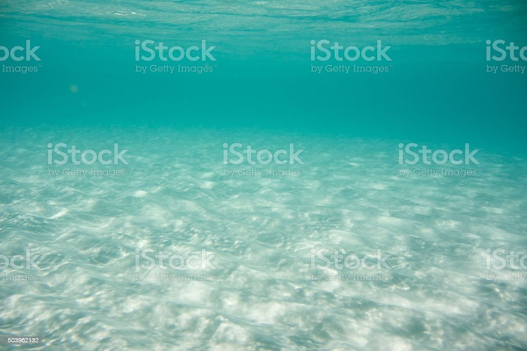 Underwater view of Whithaven beach sand stock photo