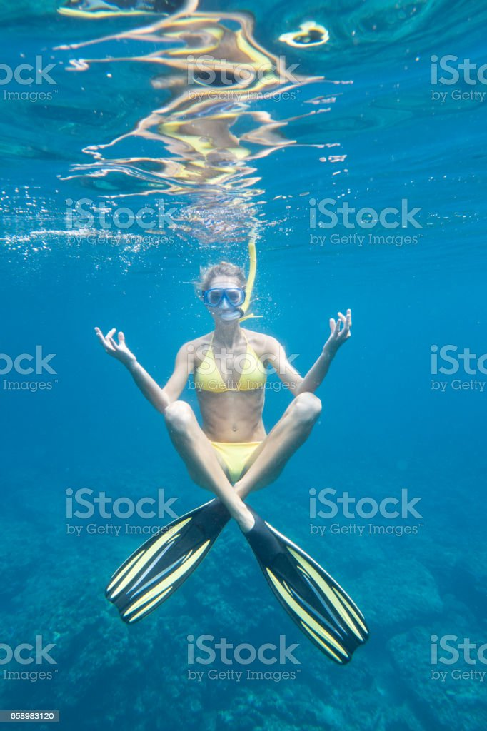 Underwater Yoga, Woman with Fins and Snorkel stock photo