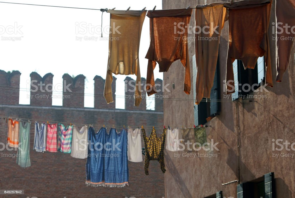 Underwear drying on a background of ancient  fortress wall of Arsenal, Venice, Italy stock photo