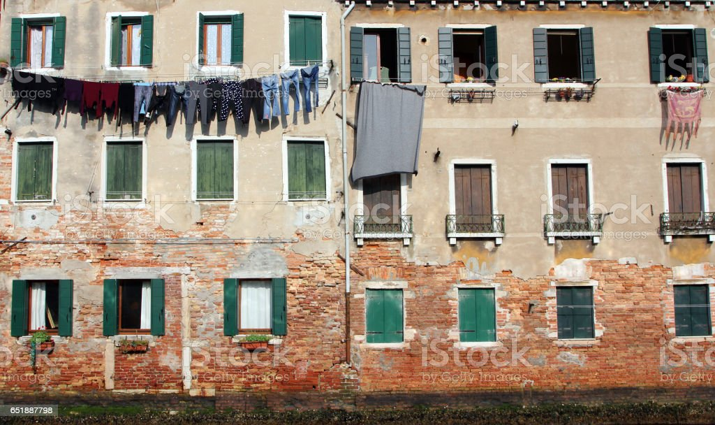 Underwear drying on the wall of the old stone house, Venice, Italy stock photo