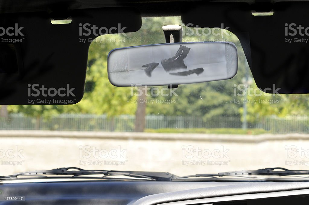 Underwear flying in car back seat stock photo