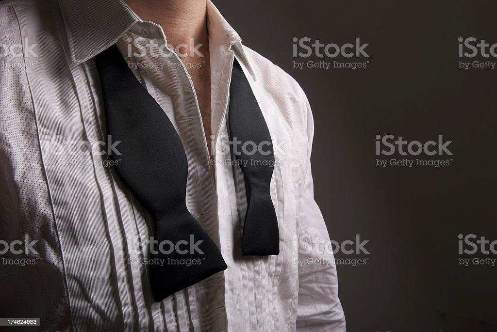 Undone Black Tie White Tuxedo Shirt Close-Up Copy Space royalty-free stock photo