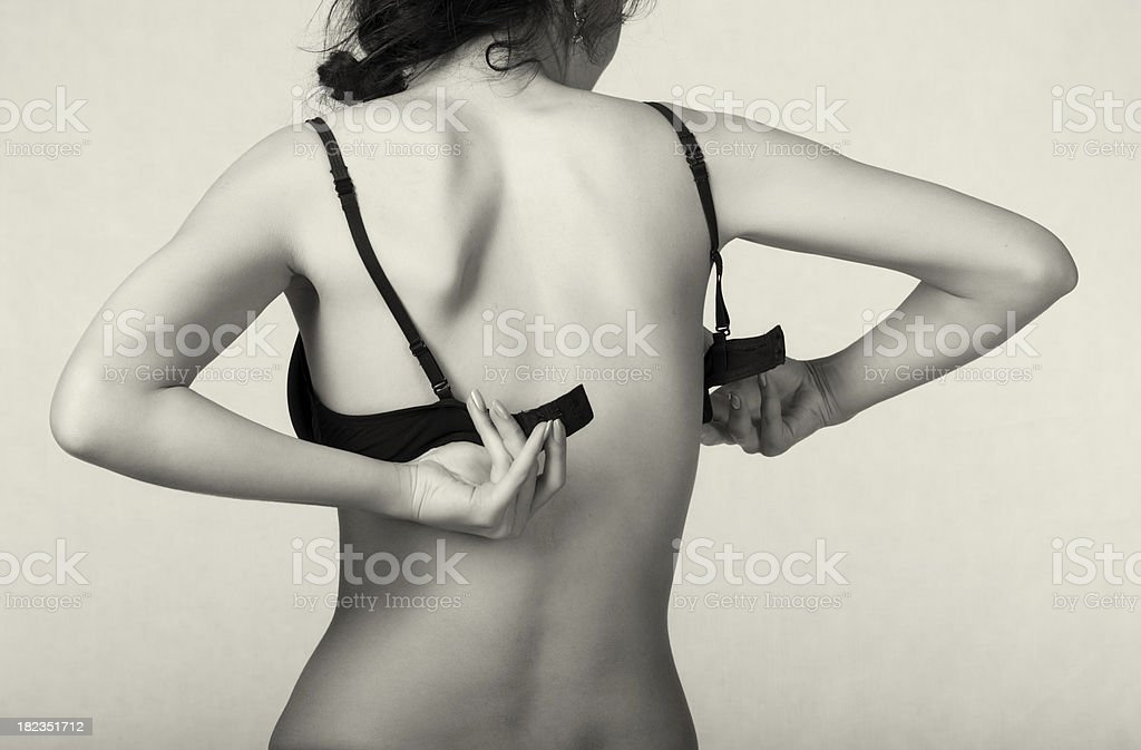 Undressing woman royalty-free stock photo