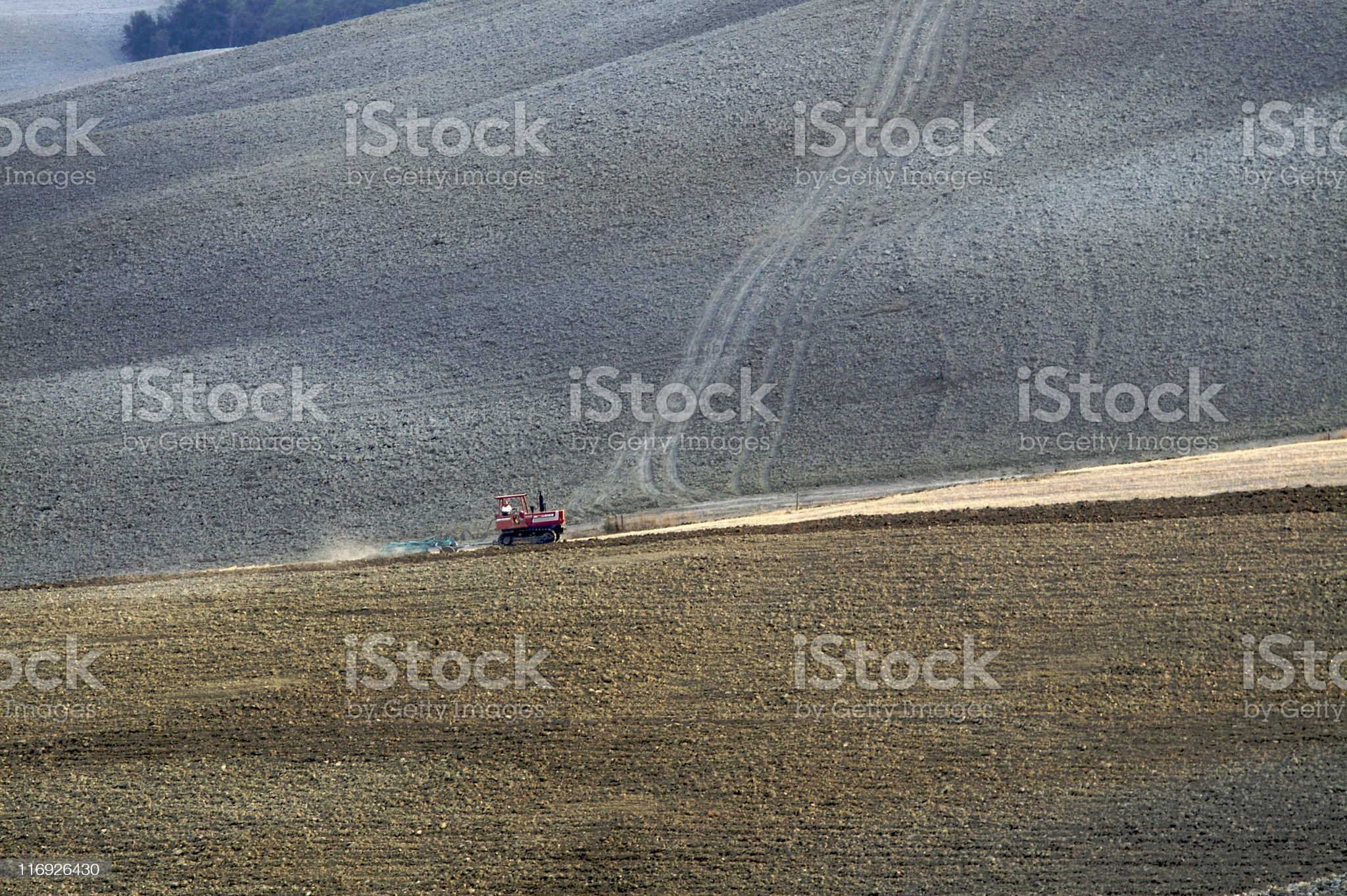 Undulating hills and farm tractor royalty-free stock photo