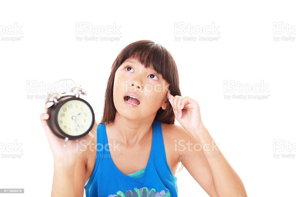 Uneasy Asian girl stock photo