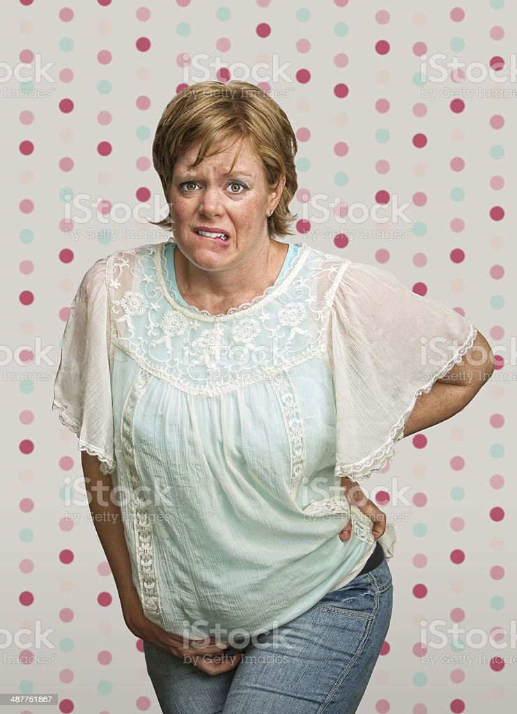 Uneasy Pregnant Lady in Pain stock photo