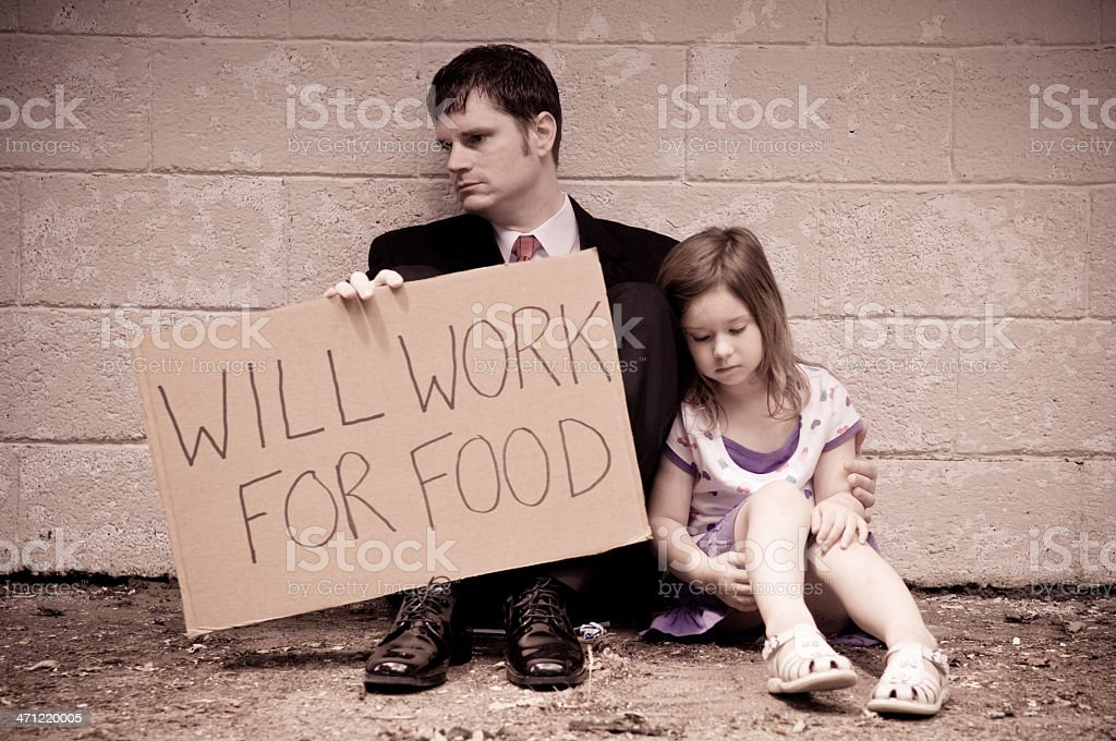 Unemployed Businessman and Daughter Holding Will Work For Food Sign royalty-free stock photo