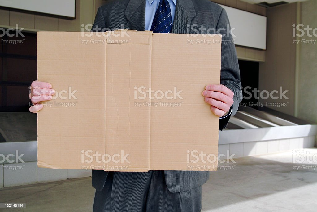Unemployed Businessman Holding a Blank Cardboard Sign stock photo