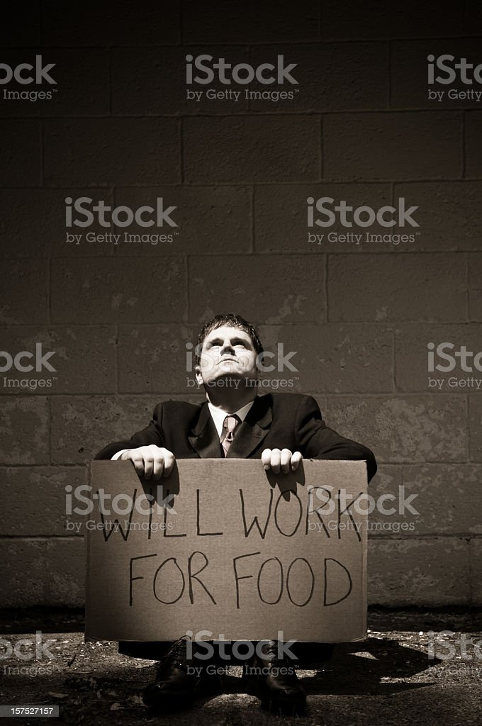 Unemployed Businessman Holding Will Work For Food Sign stock photo
