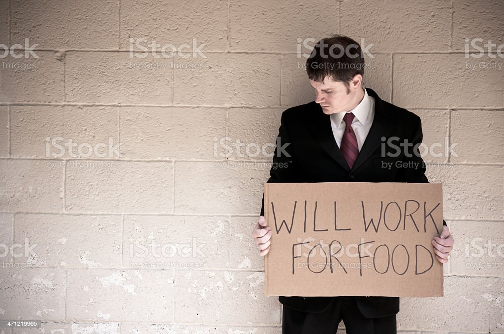Unemployed Businessman Holding Will Work For Food Sign royalty-free stock photo