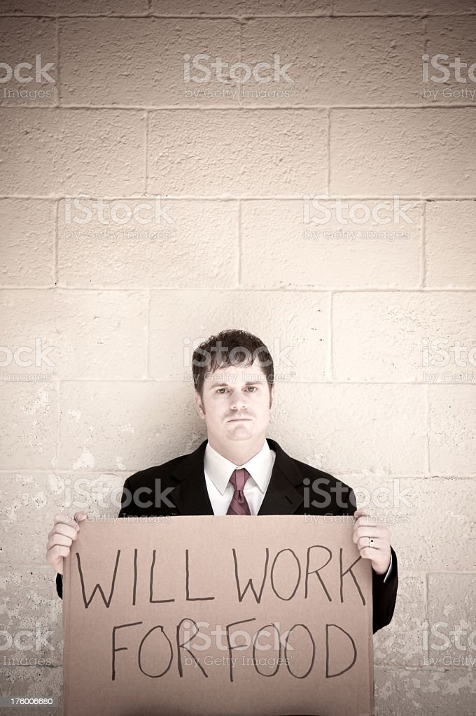Unemployed Businessman Will Work For Food stock photo