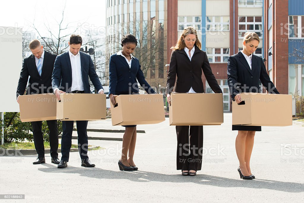 Unemployed Businesspeople With Cardboard Boxes stock photo
