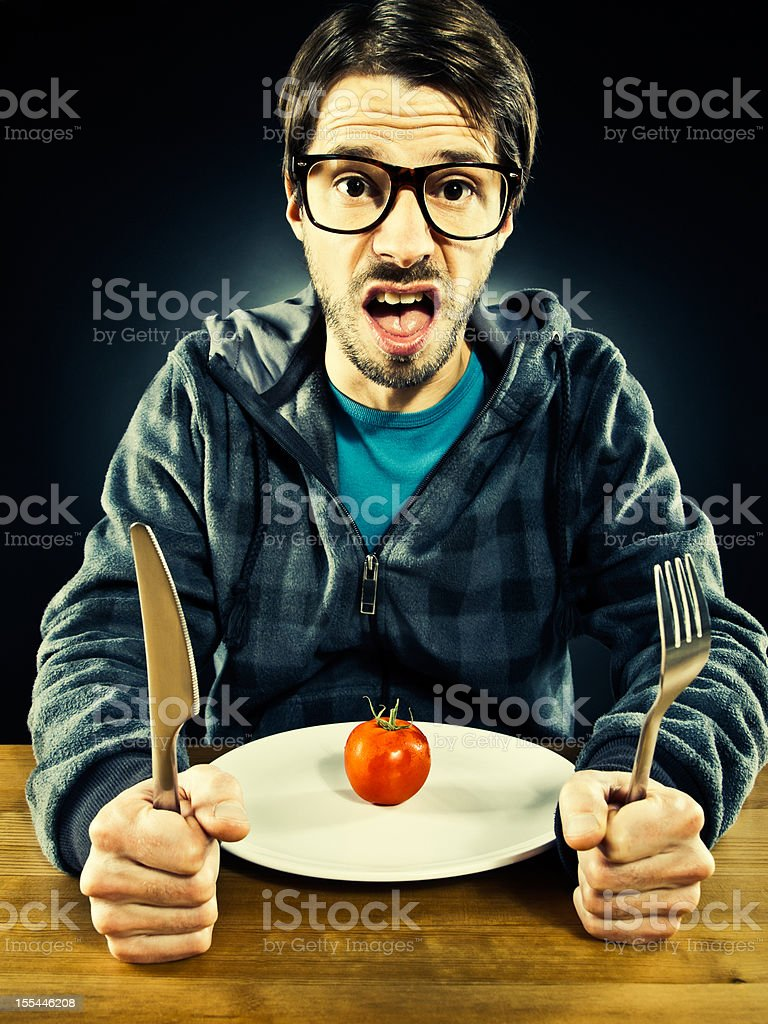 Unemployed man have to tighten the belt, eats poorly royalty-free stock photo