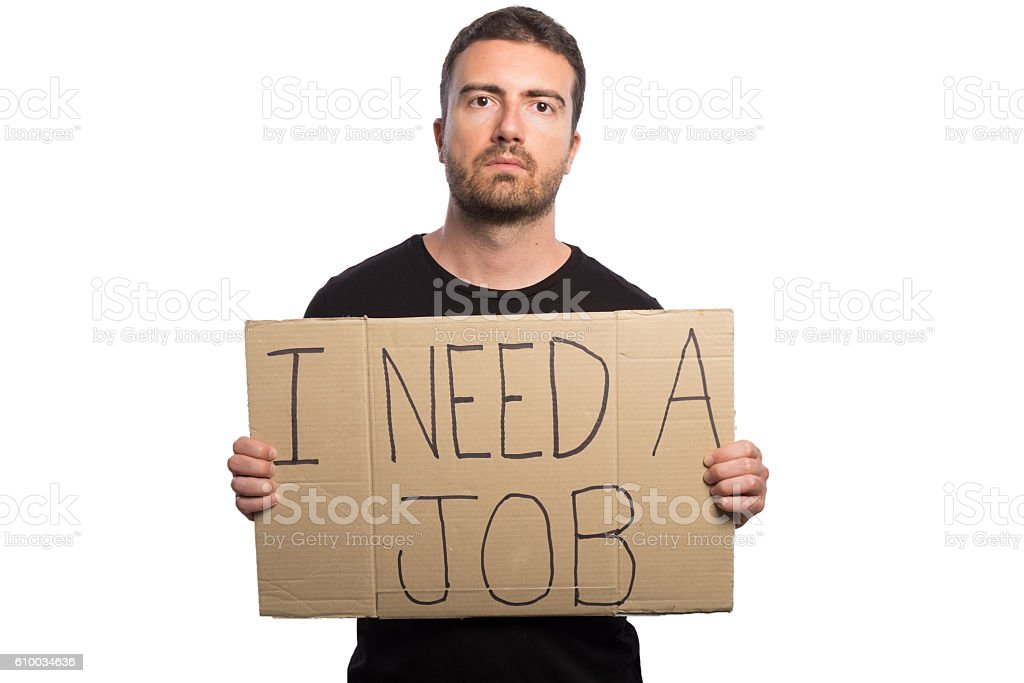 Unemployed man holding a cardboard isolated on white background stock photo