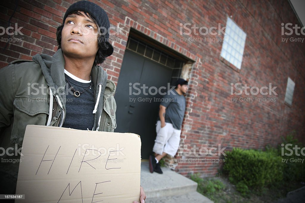 Unemployed Men on the Street Looking for Employment royalty-free stock photo