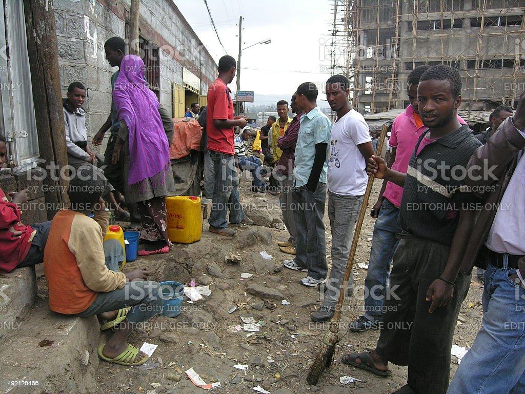 Unemployed men wait for work at Mercato, Addis Ababa, Ethiopia. stock photo
