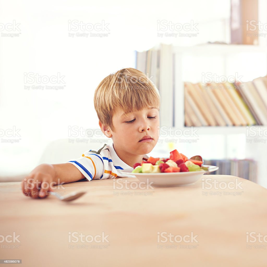 Unenthusiastic about fruit stock photo