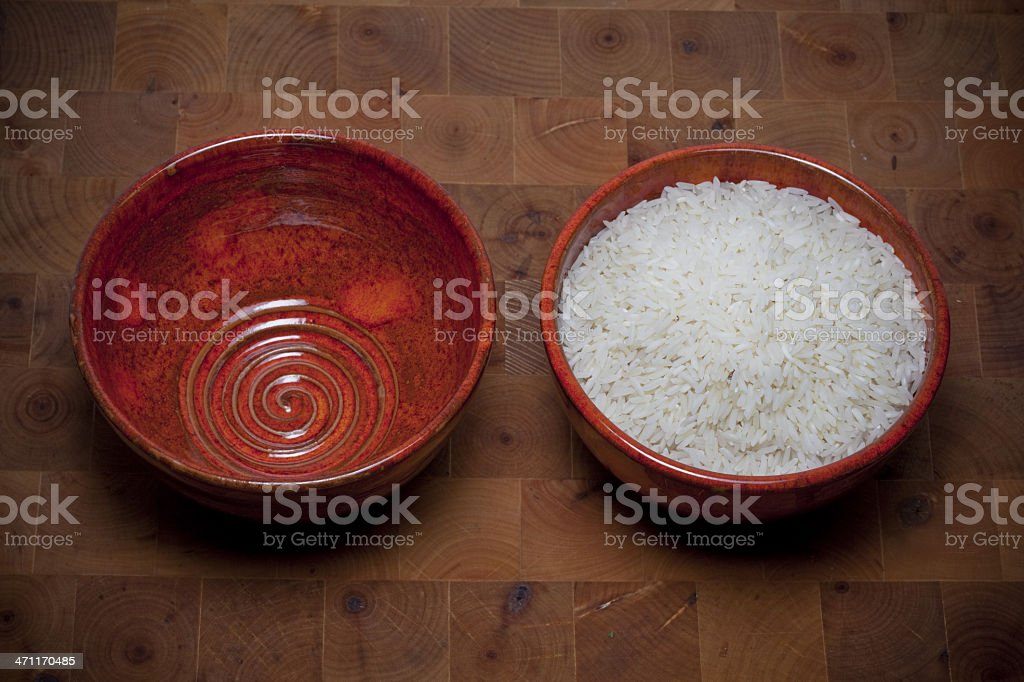 Unequal rice portions stock photo