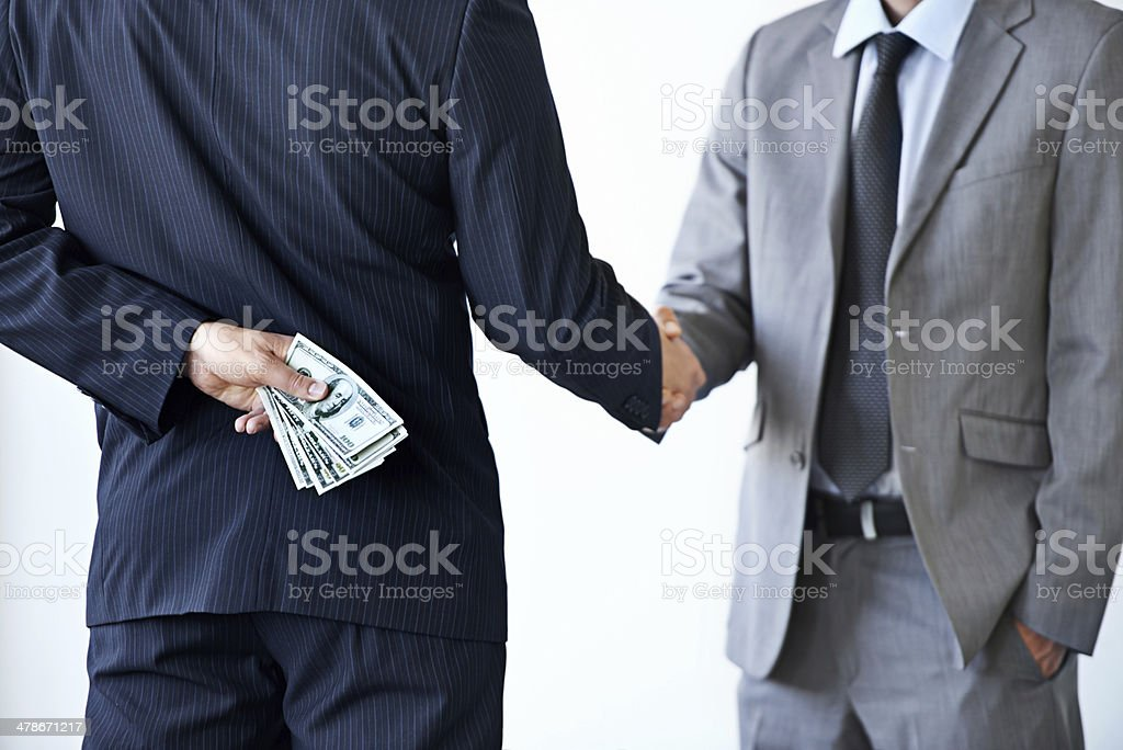 Unethical transaction in progress stock photo