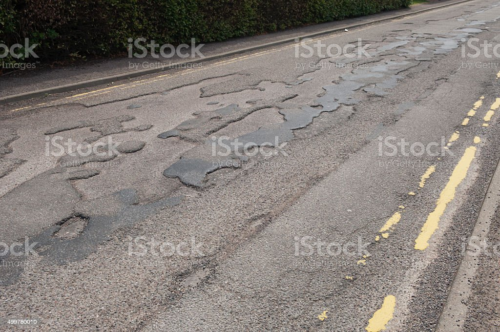 Uneven road surface stock photo