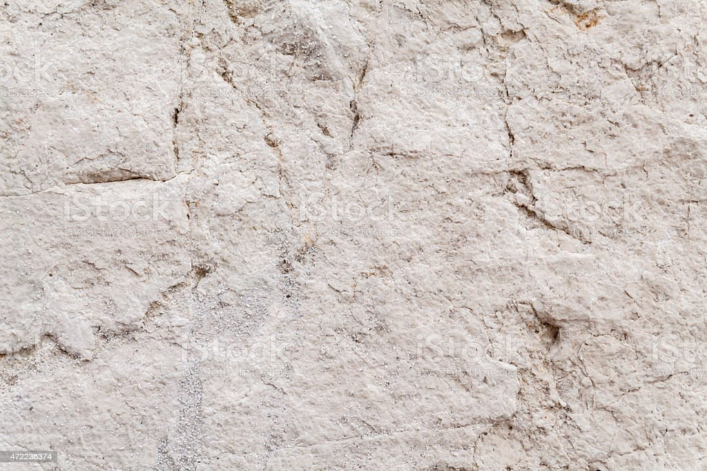 Uneven Surface Texture Of An Ancient Square Stone stock photo