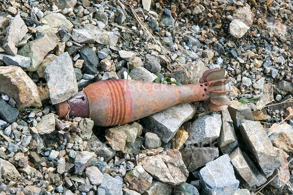 Unexploded projectile in the field stock photo