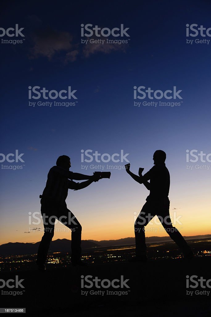 Unfair Fight- Silhouette royalty-free stock photo