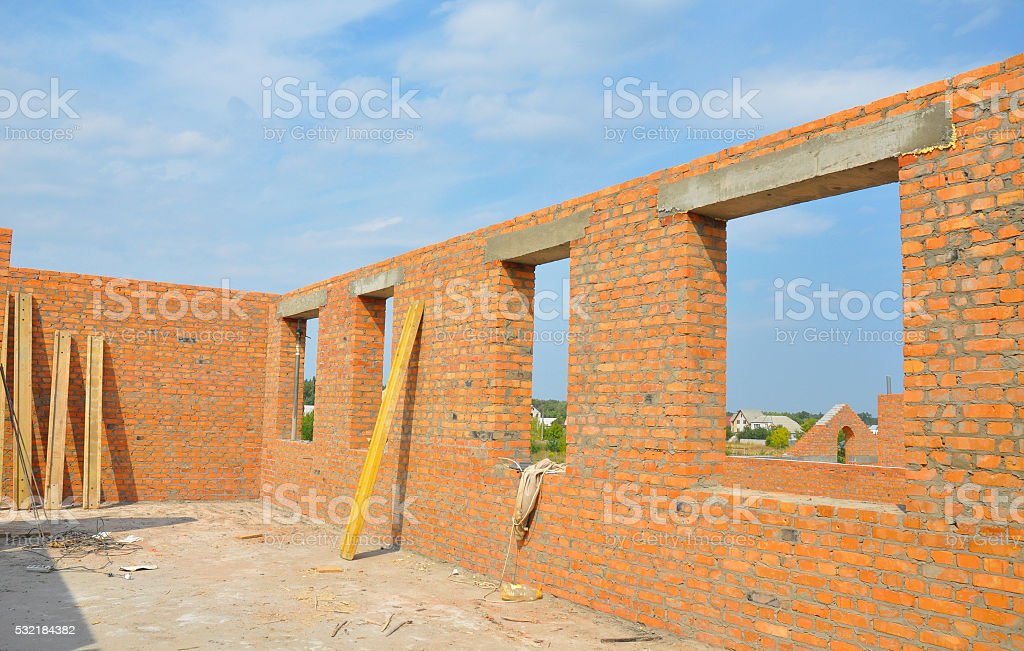 Unfinished Brick House Walls under Construction stock photo