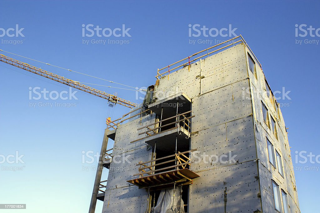 Unfinished building and crane jib royalty-free stock photo