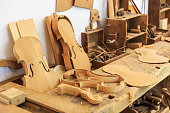 Unfinished viola and wooden tools in workshop