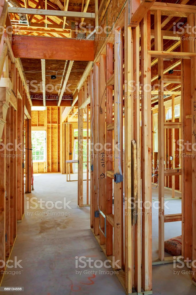 unfinished wood frame building or house stock photo