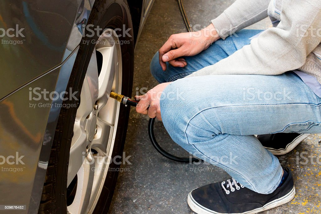 unflating tire of car stock photo