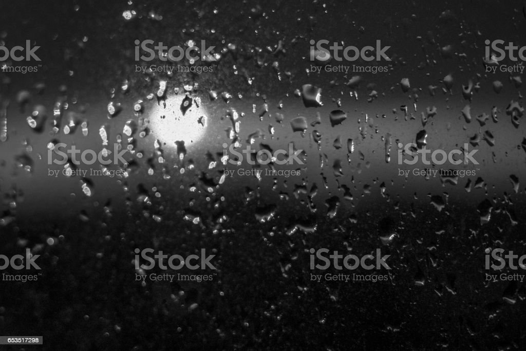 Unfocuced sun and water drops on the window stock photo