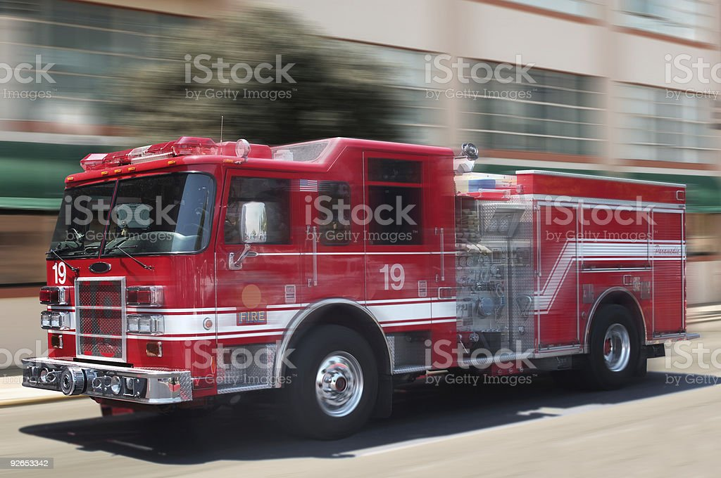 A unfocused image of a classic red fire engine stock photo